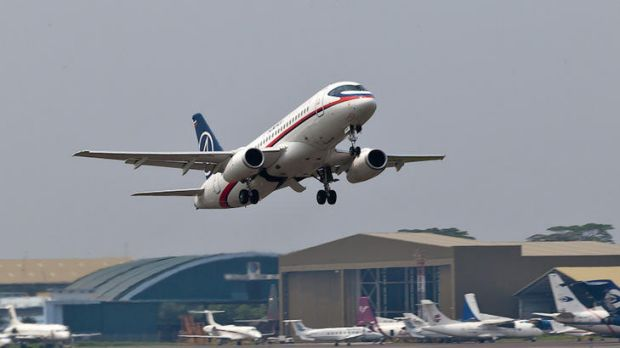 In this photo released by Sergey Dolya, a Sukhoi Superjet-100 takes off from Halim Perdanakusuma airport in Jakarta.