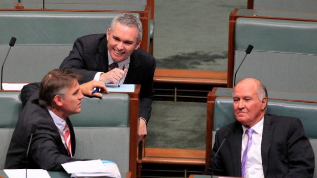 Independent MP Craig Thompson talks with Rob Oakeshott (left) and Tony Windsor (right) during question time at ...
