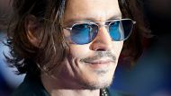 LONDON, ENGLAND - MAY 09: Actor Johnny Depp attends the European premiere of 'Dark Shadows' at Empire Leicester Square ...