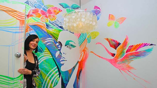 ''Edgy and urban'' … Shannon Crees with the art work she painted for interior designer Melissa Collison.