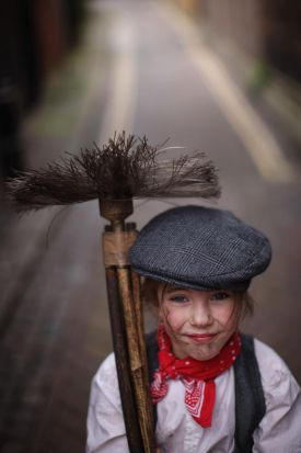 Eden Capeling 8, poses for a photograph dressed as a chimney sweep.