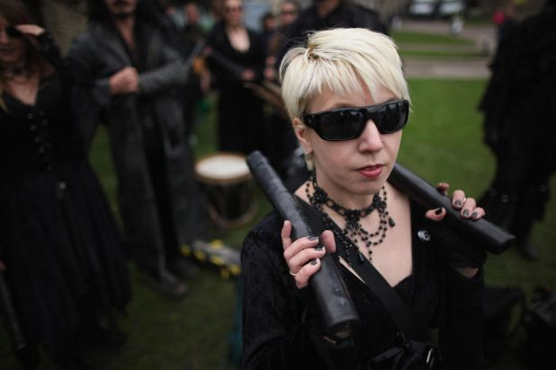 A woman from the Wolf's Head and Vixen Morris dance team waits to take part in the annual Sweeps Festival.