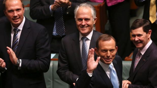 Opposition Leader Tony Abbott waves after he delivered his Budget reply speech in the House of Representatives.