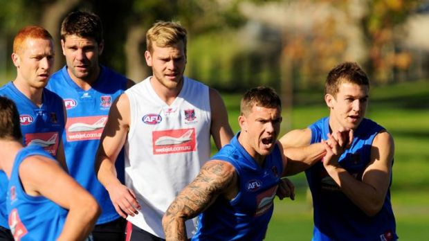 Hard yards: Melbourne's Matthew Bate, Mark Jamar, Jack Watts, Brent Moloney and Jack Trengove during training yesterday.