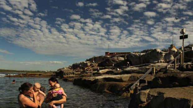 Sudden comfort … Alice Veersema, left, and her son Henry enjoy the warmer water of Mahon pool at Maroubra with ...