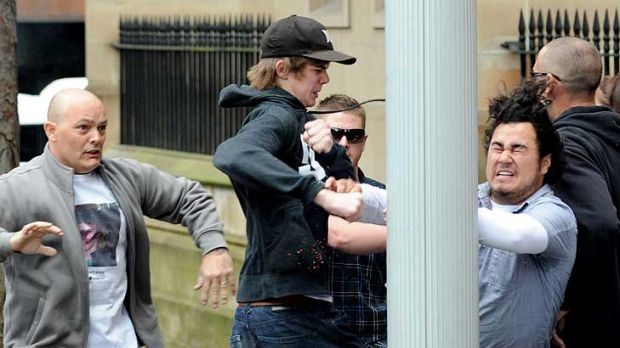 A fight breaks out between supporters of Todd Burrows and Jay William Cook at St James Court in Sydney.