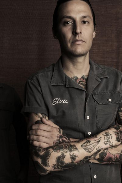 Elvis Abrahanowicz from Porteno and Bodega, Surry Hills.  Abrahamowicz's right forearm tattoos include a knife through ...