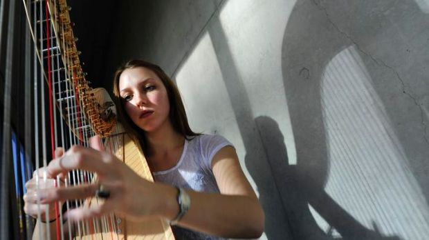 ANU music student and harp player Melina van Leeuwen practises in the halls of the university.