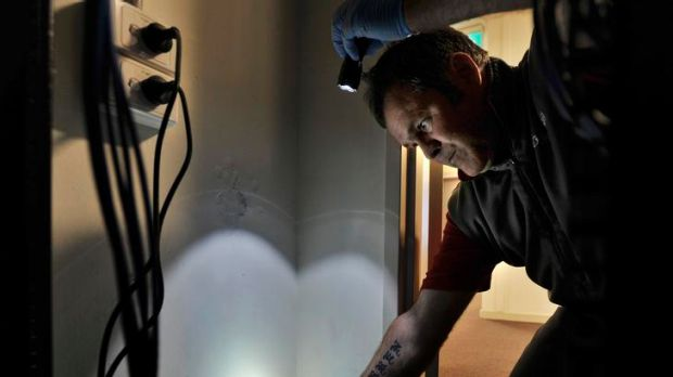 Rentokil Pest Management Technician Keith Mathewson inspects rodent bait traps in the newly built Uni Lodge apartments ...