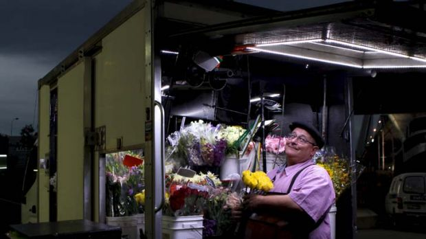 Moving with the times ... flower seller Russell Sharp, who drives to business hot spots around Sydney offering produce ...