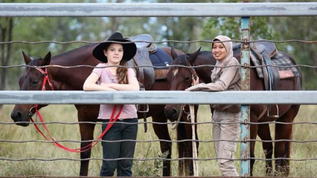 ''All the locals have been very friendly'' ... Kirra Rigg, 10, with the Indonesian animal husbandry student Safitri, 20, ...