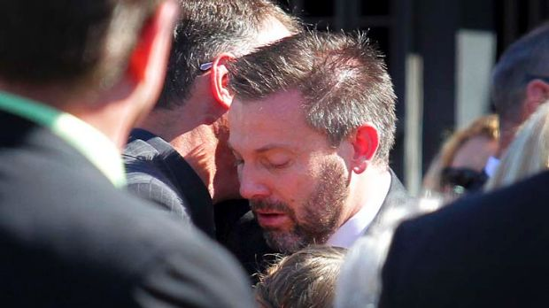 Gerard Baden-Clay is comforted by friends and family at the funeral of his slain wife, Allison, at St Paul's Anglican ...