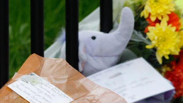 Tributes are left near the scene of a house in which  five children died in Derby.