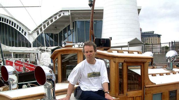 Chris Jagger sits on the launch built by his grandfather, Alfred Scutts, that now resides in the National Maritime Museum.