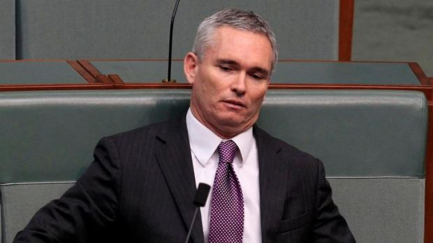 Independent MP Craig Thompson resumes his seat after speaking on indulgence during Christopher Pyne's attempt to force ...