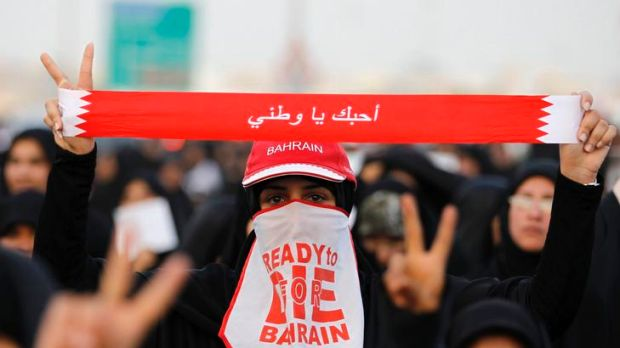 An anti-government protester participates in a march held by Bahrain's main opposition party Al Wefaq in the village of ...