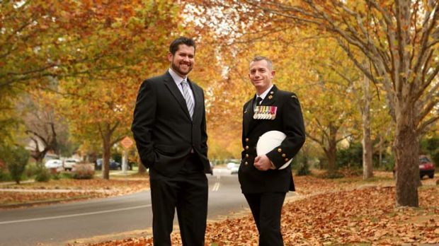 Inclusive … Chief Petty Officer Stuart O'Brien, right, with his partner, Chris Matterson.