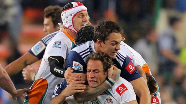 Cheetahs centre Andries Strauss is tackled by Stormers flanker Rynardt Elstadt.