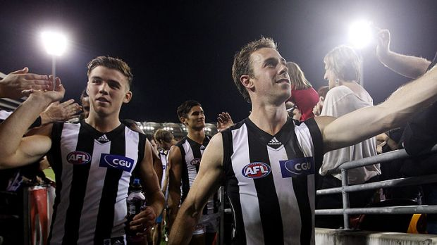 The Magpies celebrate winning the round seven AFL match between the Brisbane Lions and the Collingwood Magpies at The ...