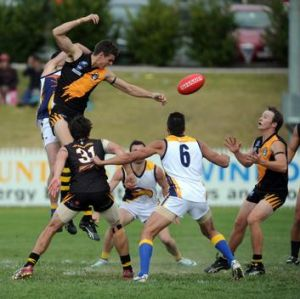 Queanbeyan Tigers' Nathan Kerlin gets a tap away to teammate Will Griggs.