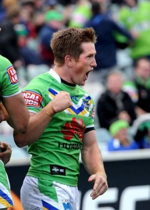 Raiders' Josh McCrone celebrates after teammate Jack Wighton scored a try.