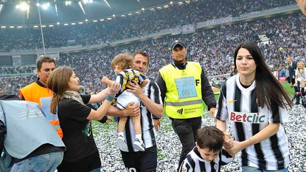 Skipper Alessandro Del Piero celebrates with his wife Sonia Amoruso (right) after Juventus won its 28th Serie A title.
