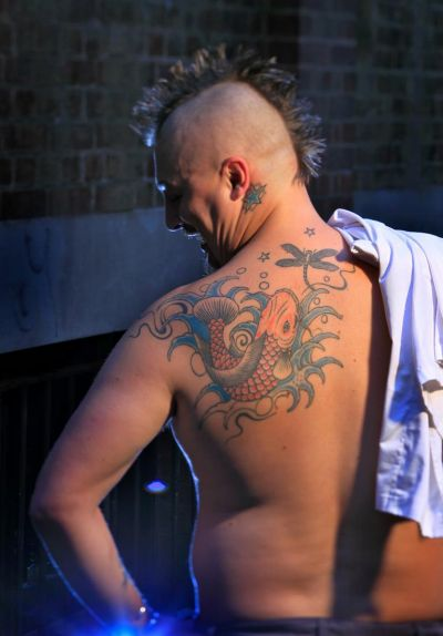 Chef Ben Cooper's tattooed back.