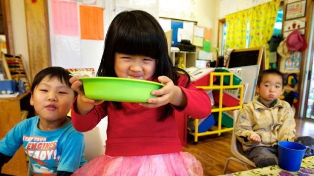 Outside food ban ... four-year-olds Joseph Lee, Joyce Zhang and David Car, at the Daisy Learning Centre in Campsie, ...