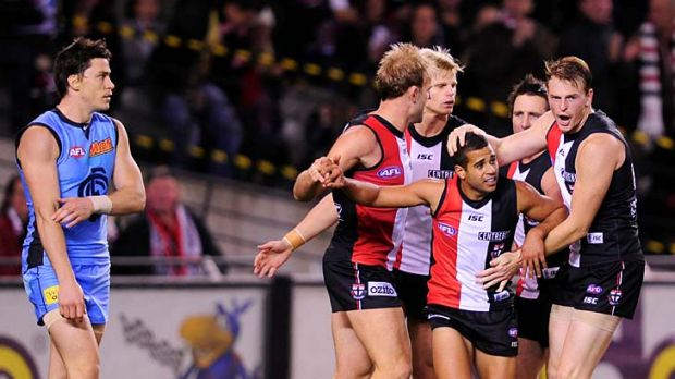 What he Saad: Saints players celebrate a goal with rookie Ahmed Saad, centre, in the win over Carlton last night.