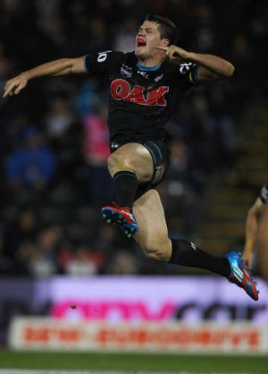 Lachlan Coote of the Panthers celebrates kicking a field goal in golden point time to win the match during the round 10 ...