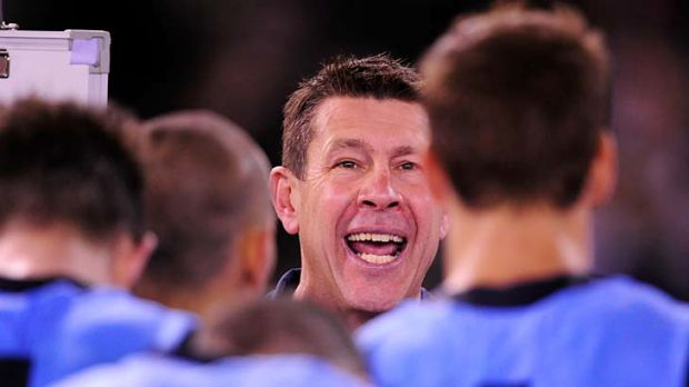 An animated Brett Ratten speaks to his players at three-quarter-time.