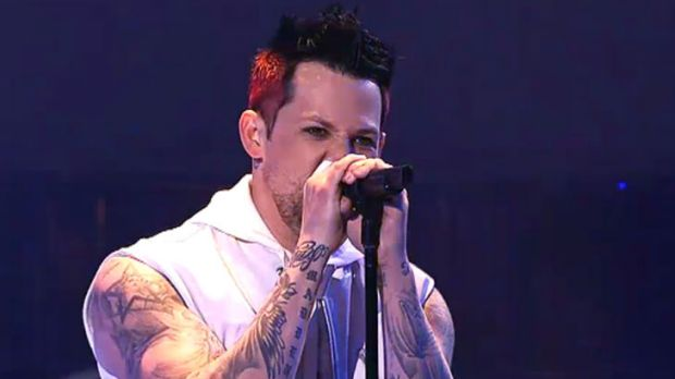 Joel Madden kicks off the performance of <i>Sing</i> by <i>The Voice</i> coaches.