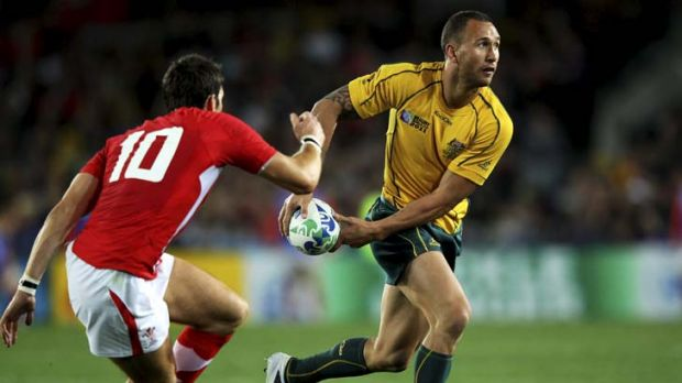 Elusive … Wallaby Quade Cooper out-steps a Welsh defender during a Rugby World Cup game in Auckland; and inset, as ...