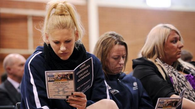 Lauren Jackson and Kristi Harrower read the booklet on fellow inductees yesterday.