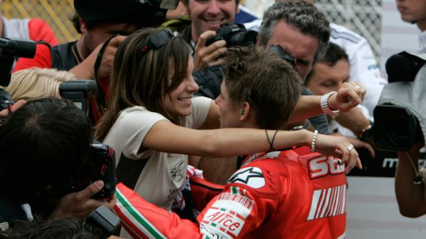 Family man ... Casey Stoner is congratulated by wife Adriana at the Japanese GP in 2007.