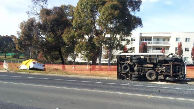 It is believed the car was turning right out of Florey Drive when it collided with the eastbound truck on Southern Cross ...