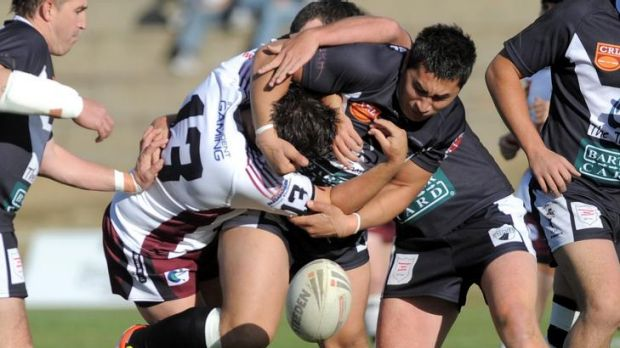 Yass's Tony McLean, right, and Queanbeyan's Troy Whiley endure a heavy collision.