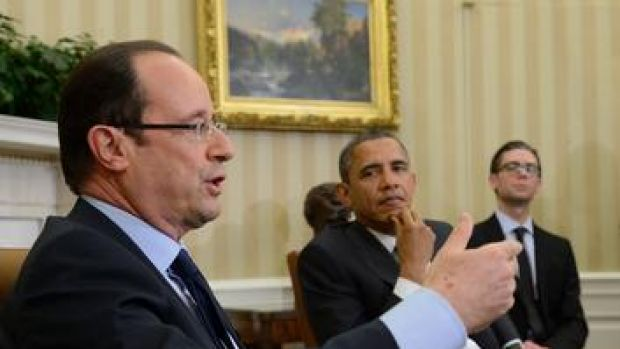 'Extraordinary importance' ... the US President, Barack Obama, listens to his French counterpart, Francois Hollande.