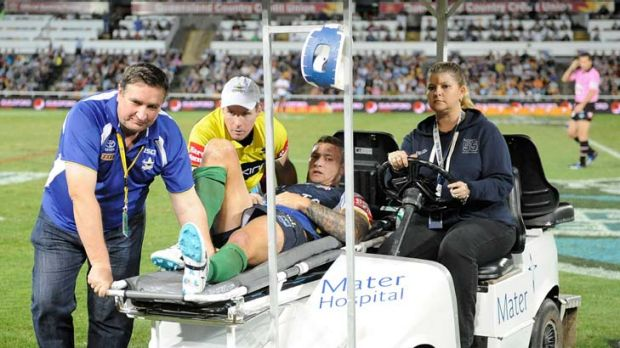 Busted ... Tariq Sims leaves the field after breaking his leg.