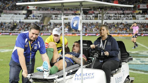 Tariq Sims is taken off the field with a suspected broken leg.