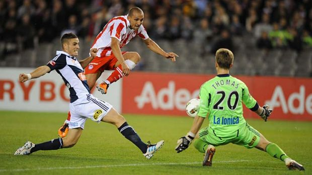 Rafik Djebbour (middle), of Olympiakos, shoots at goal against Melbourne Victory in its May friendly. Victory is now ...