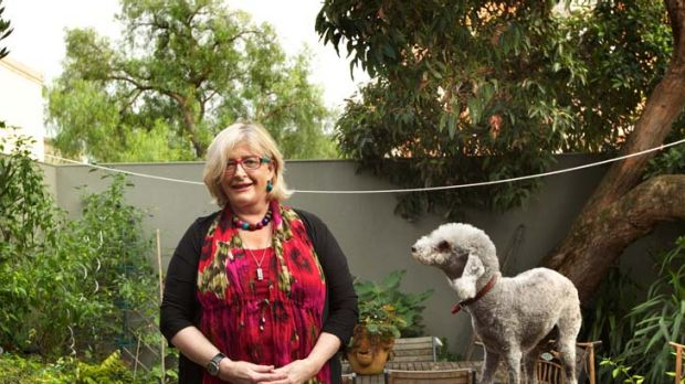 Retiring Health Services Commissioner Beth Wilson and her dog Dooli at home.
