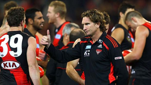 Thumbs up: Bomber coach James Hird shows his satisfaction after his side's win last night.