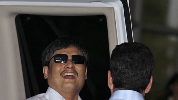 Blind Chinese dissident Chen Guangcheng  smiles  as he arrives in New York.