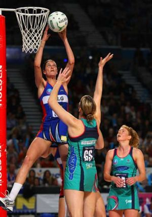 Anna Harrison of the Mystics blocks the shot of Karyn Howarth of the Vixens during the round eight of the ANZ Championship.