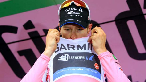 A good day ... Garmin's Ryder Hesjedal of Canada kisses the leader's pink jersey.