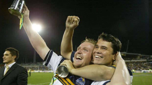 Bill Young, left, celebrates the Brumbies' 2004 Super Rugby title with Jeremy Paul.