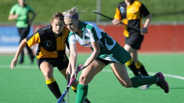 Old Canberrans' Fairlie Hawke tackles St Patrick's player Clare Hanrahan.