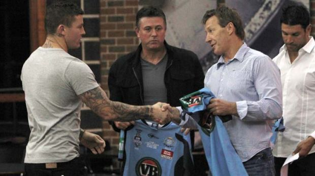Handover ... Melbourne coach Craig Bellamy gives Blues five-eighth Todd Carney his State of Origin game jersey last ...