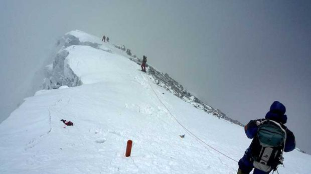 Coming down ... climbers descend from the summit of Everest  on Saturday.